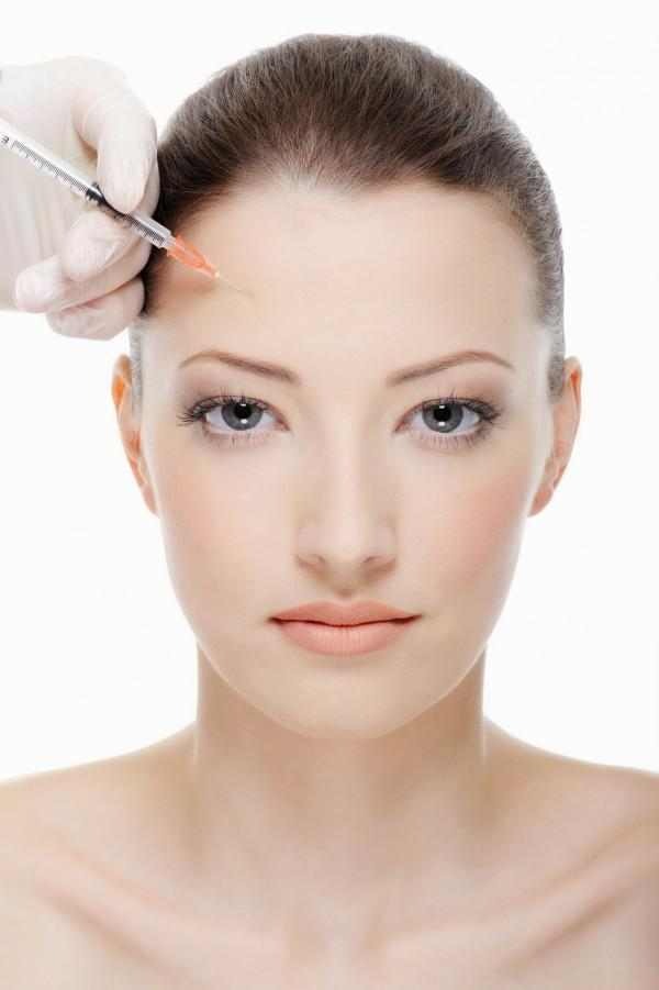 injection of botox on female forehead - female portrait